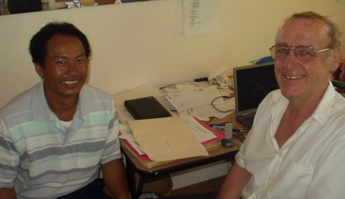 Hou, a Burmese Refugee being assisted by Peter Hallam, CEO.
